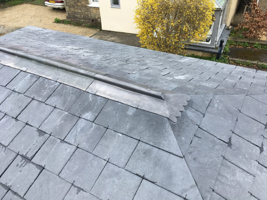 lead over wood roll (mopstick) with close mitred slates