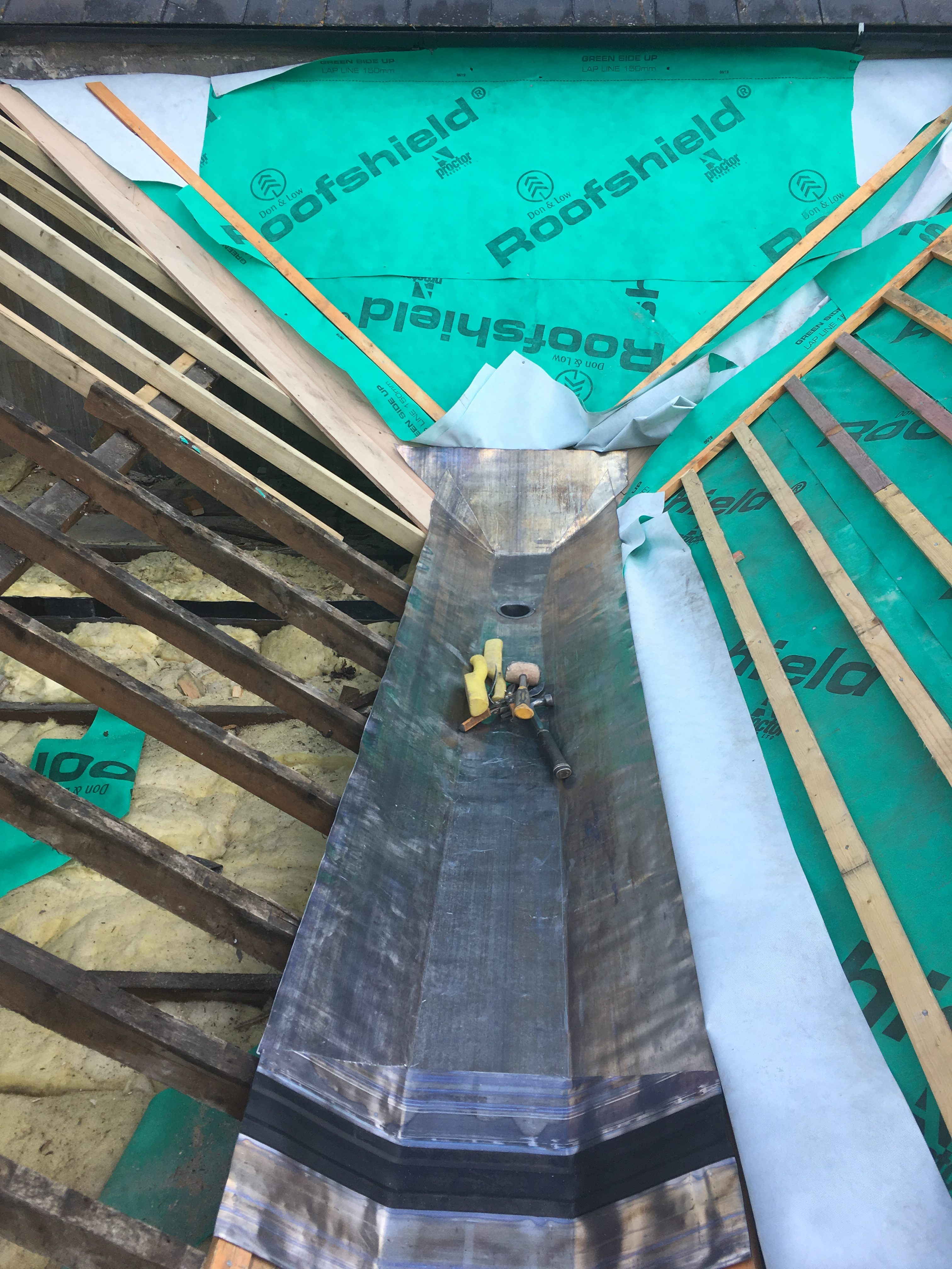 Code 6 lead valley gutter with T-Pren expansion joint