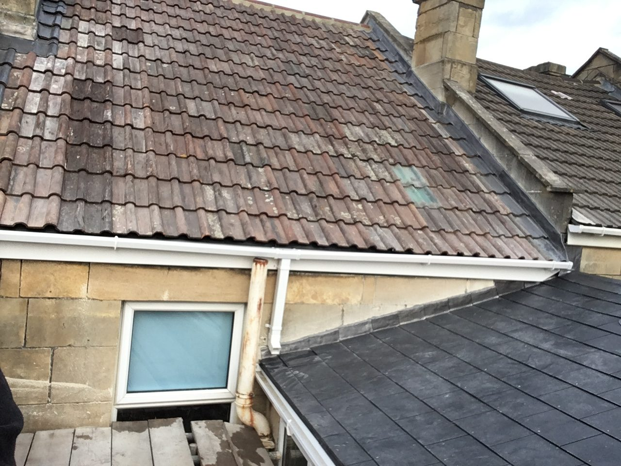 Clay double roman roof in Oldfield Park Bath, also low pitched slate roof with Easy slate rubber inserts allowing for a 12 degree pitch