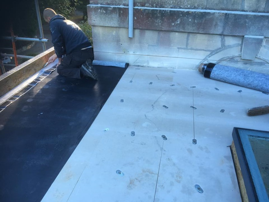 TR27 Insulation being fitted before a rubber single ply