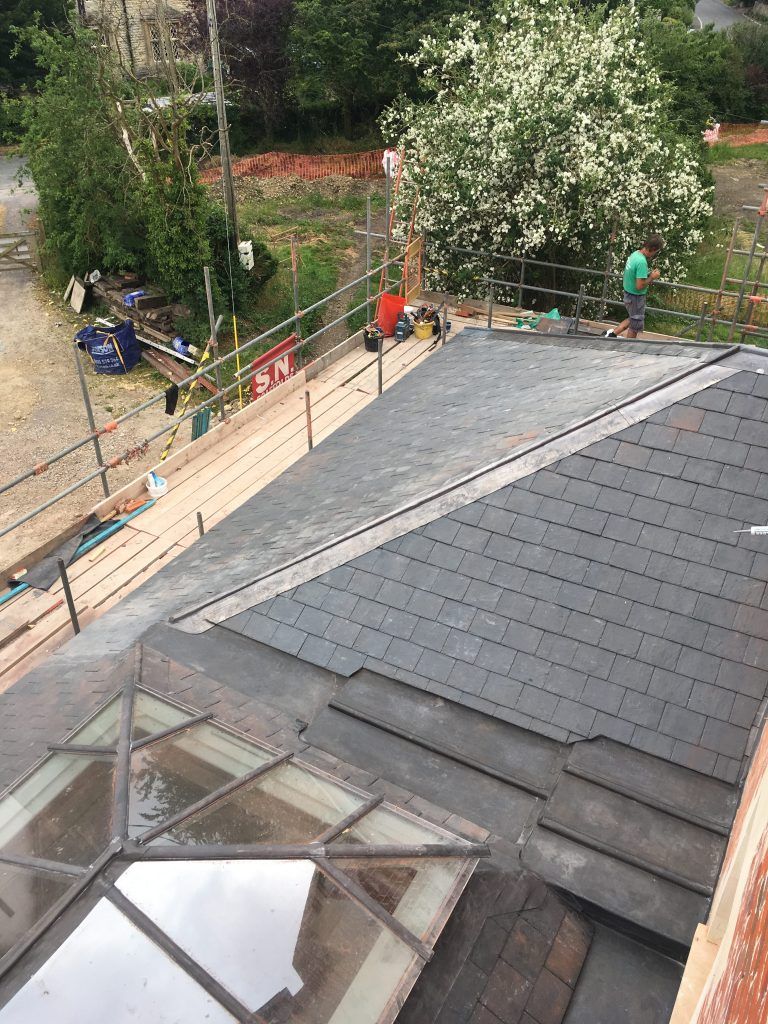 Natural Spanish slates with lead hips and ridges looking down on lead bays